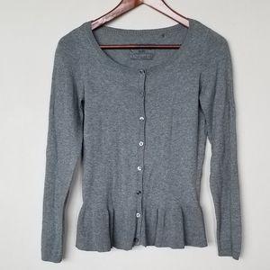 Grey ruffled feminine cardigan